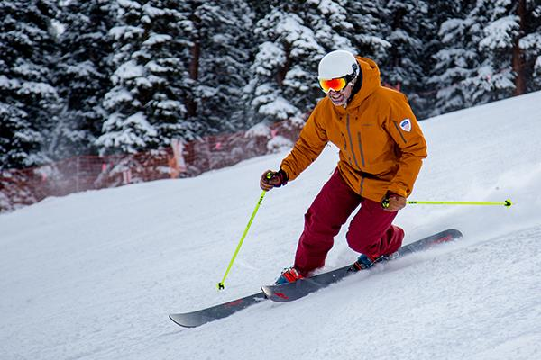 Telemark skier going down a hill.