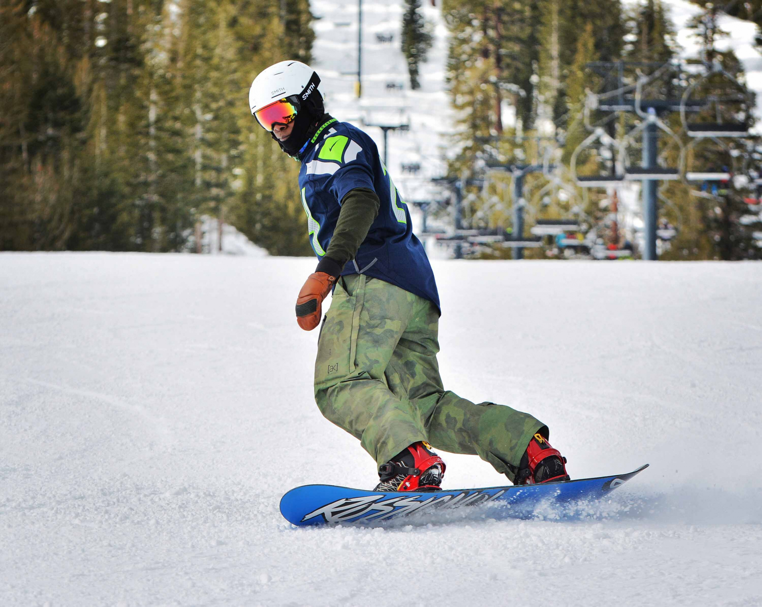 PSIA-AASI Member Marshal Titus snowboard in a Seattle Seahawks jersey
