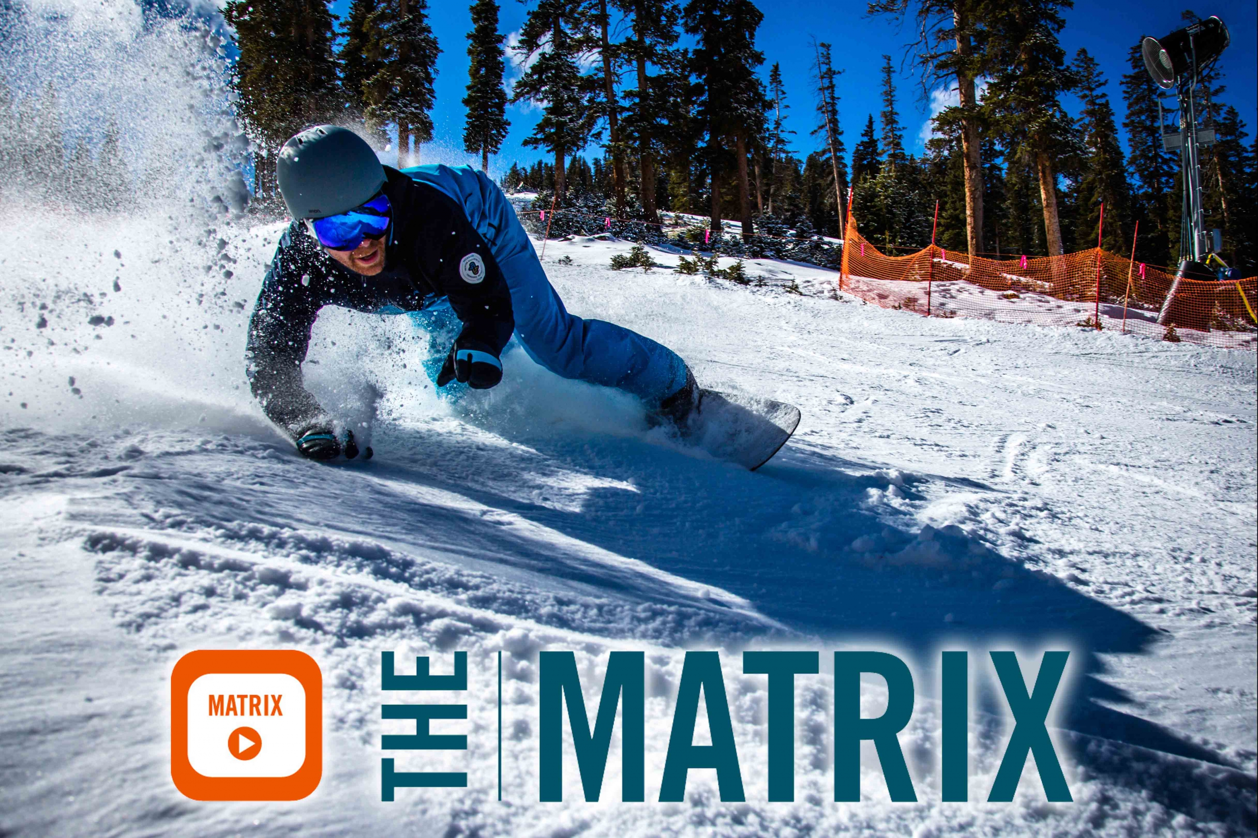 A snowboarder carves across the snow and image reads the matrix