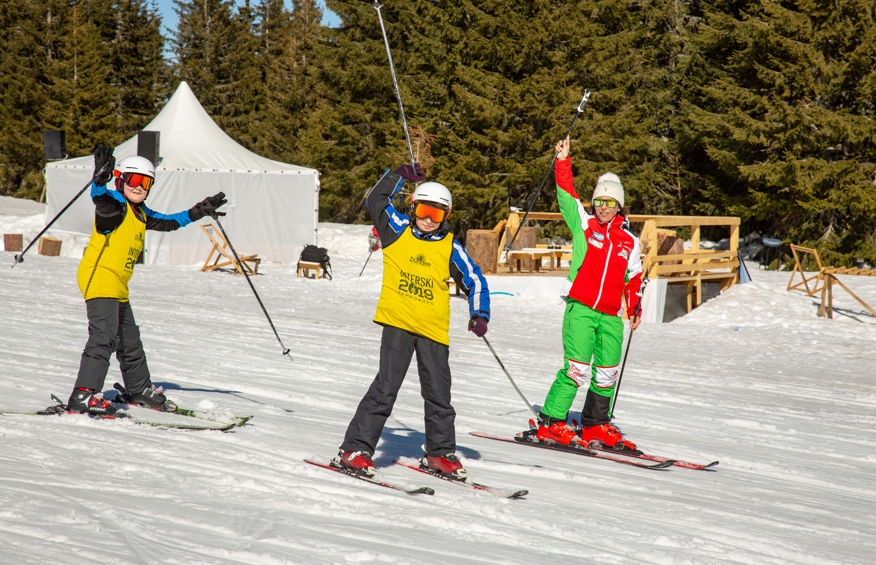Interski ski school students with their instructor at Interski 2019