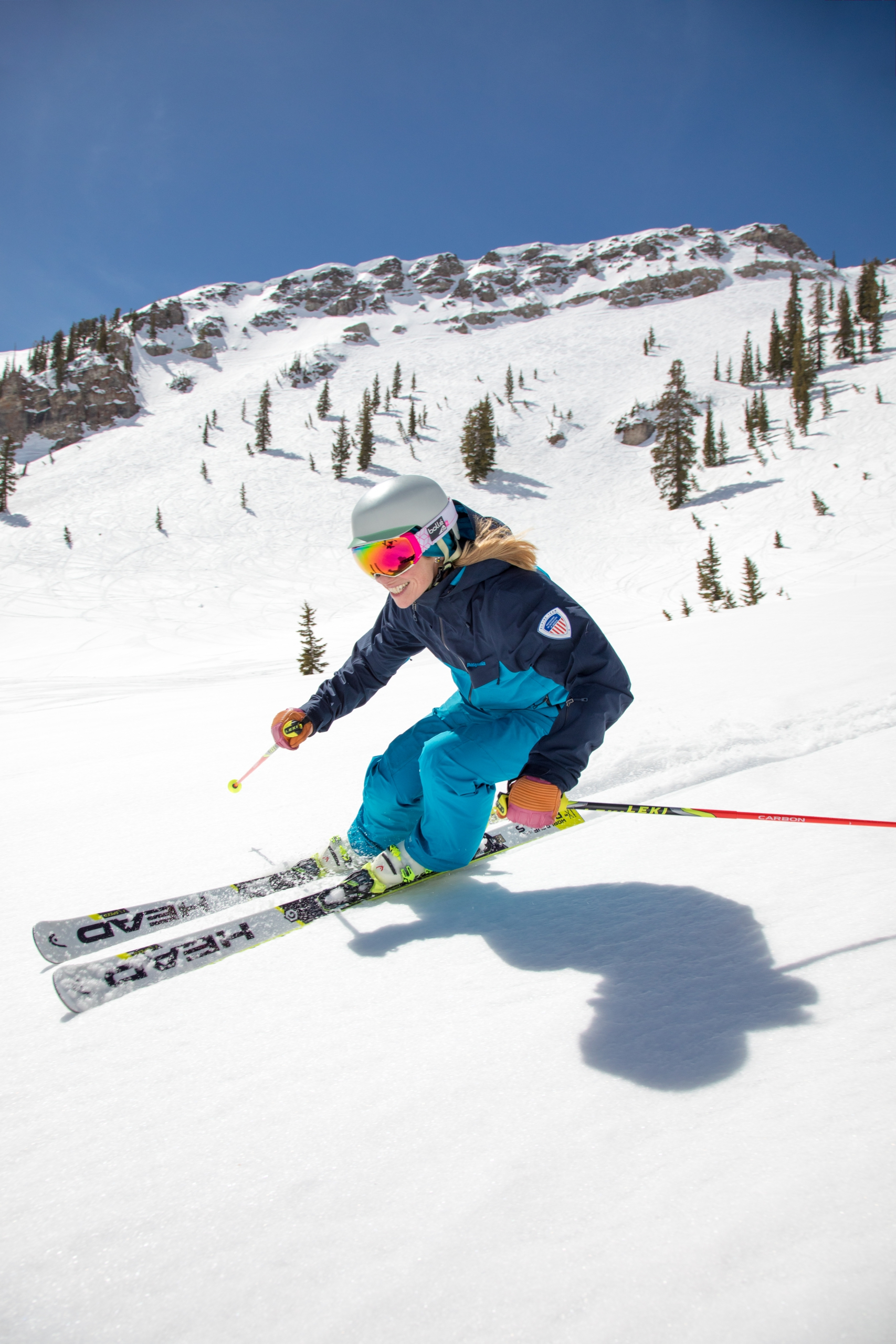 PSIA Alpine Team member Robin Barnes carves on her skis down a slope