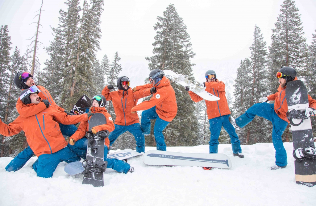 The AASI Snowboard team fake fights for the photographer