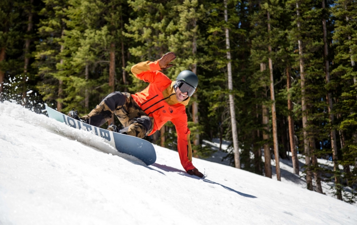 PSIA-AASI National Team Member Chris Rogers snowboard in The North Face outerwear.